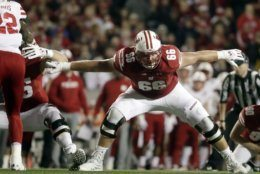 In this Oct. 6, 2018, file photo, Wisconsin's Beau Benzschawel blocks during the first half of a game against Nebraska in Madison, Wis. Benzschawel was named to the 2018 AP All-America NCAA college football team, Monday, Dec. 10, 2018. (AP Photo/Morry Gash, File)