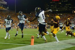 TEMPE, AZ - SEPTEMBER 03:  Wide receiver Emmanuel Butler #8 of the Northern Arizona Lumberjacks is forced out of bounds by defensive back De'Chavon Hayes #8 of the Arizona State Sun Devils in the first half of the game at Sun Devil Stadium on September 3, 2016 in Tempe, Arizona. The Arizona State Sun Devils won 44-13. (Photo by Jennifer Stewart/Getty Images)