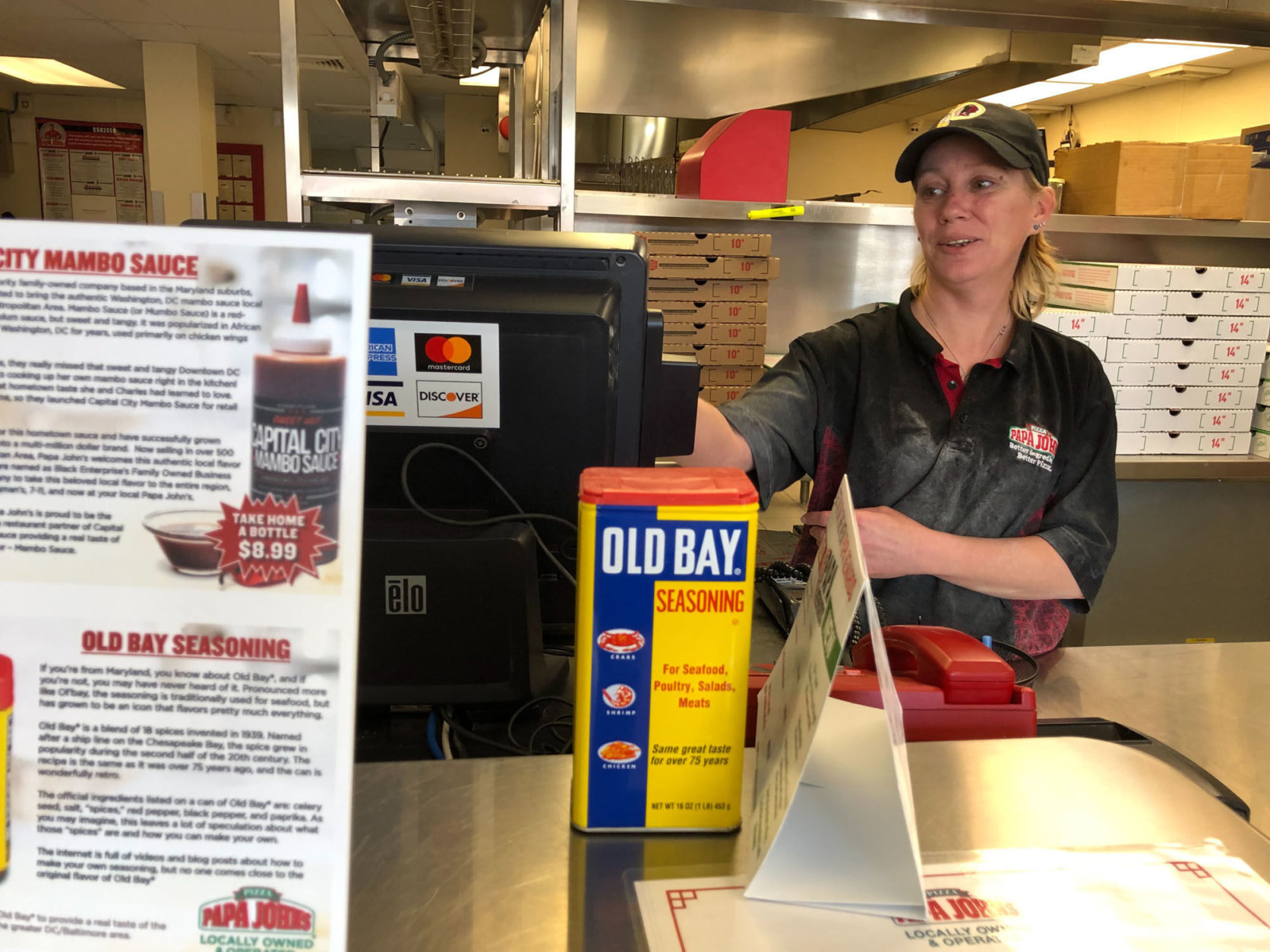 """We've been sending them pizzas to help out,"" said Holly Evans at the Papa John's. ""Anything [donated] that can help, if it's in small quantities we can get it down to them to have it dropped off."" (WTOP/Kristi King)"