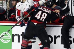 Carolina Hurricanes' Jordan Martinook (48) collides with Washington Capitals' Alex Ovechkin (8), of Russia, during the first period of Game 4 of an NHL hockey first-round playoff series in Raleigh, N.C, Thursday, April 18, 2019, (AP Photo/Karl B DeBlaker)