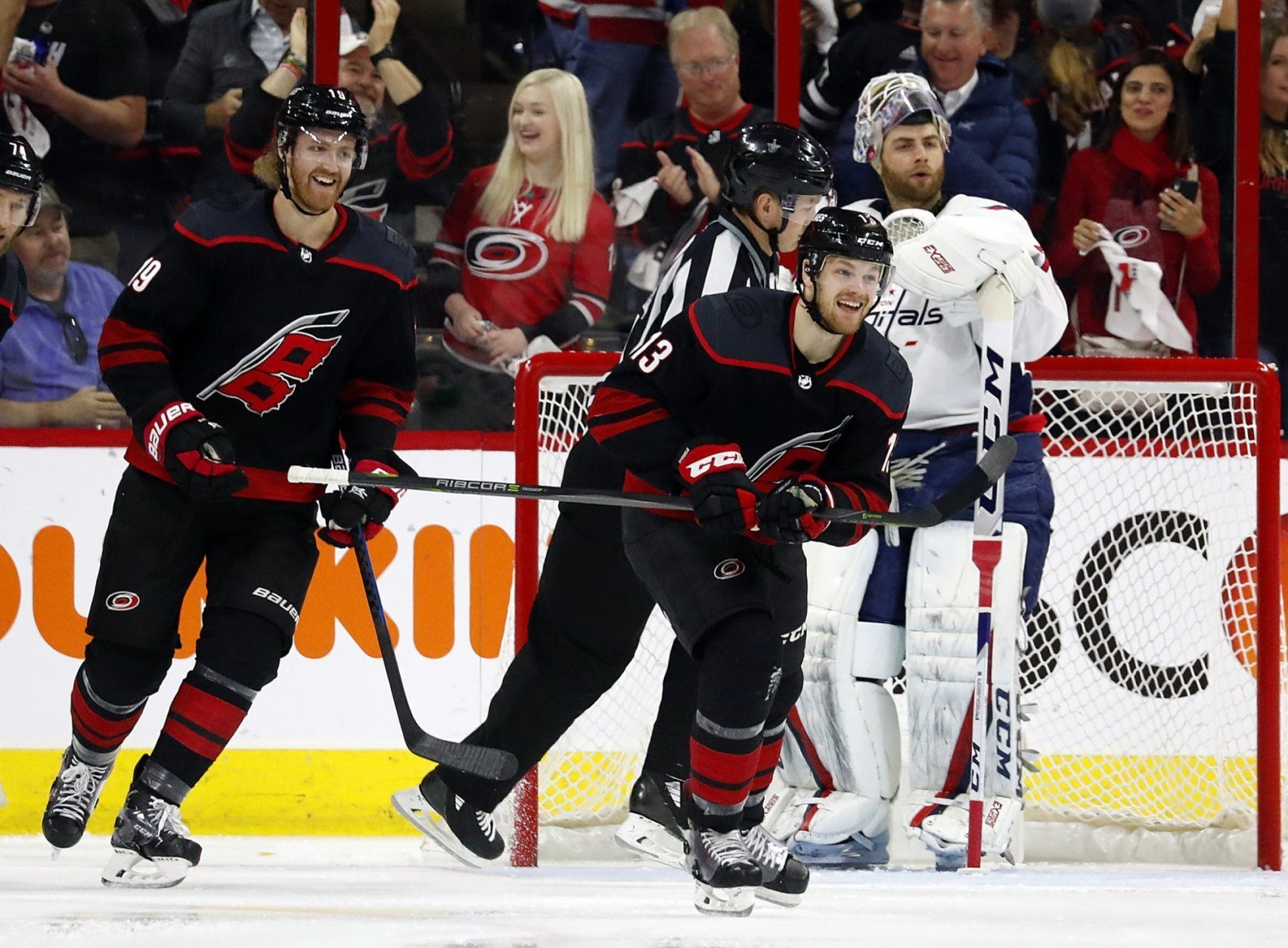 Carolina Hurricanes' Warren Foegele (13) celebrates his goal with Dougie Hamilton (19) nearby during the first period of Game 4 of the team's NHL hockey first-round playoff series against the Washington Capitals in Raleigh, N.C, Thursday, April 18, 2019, (AP Photo/Karl B DeBlaker)