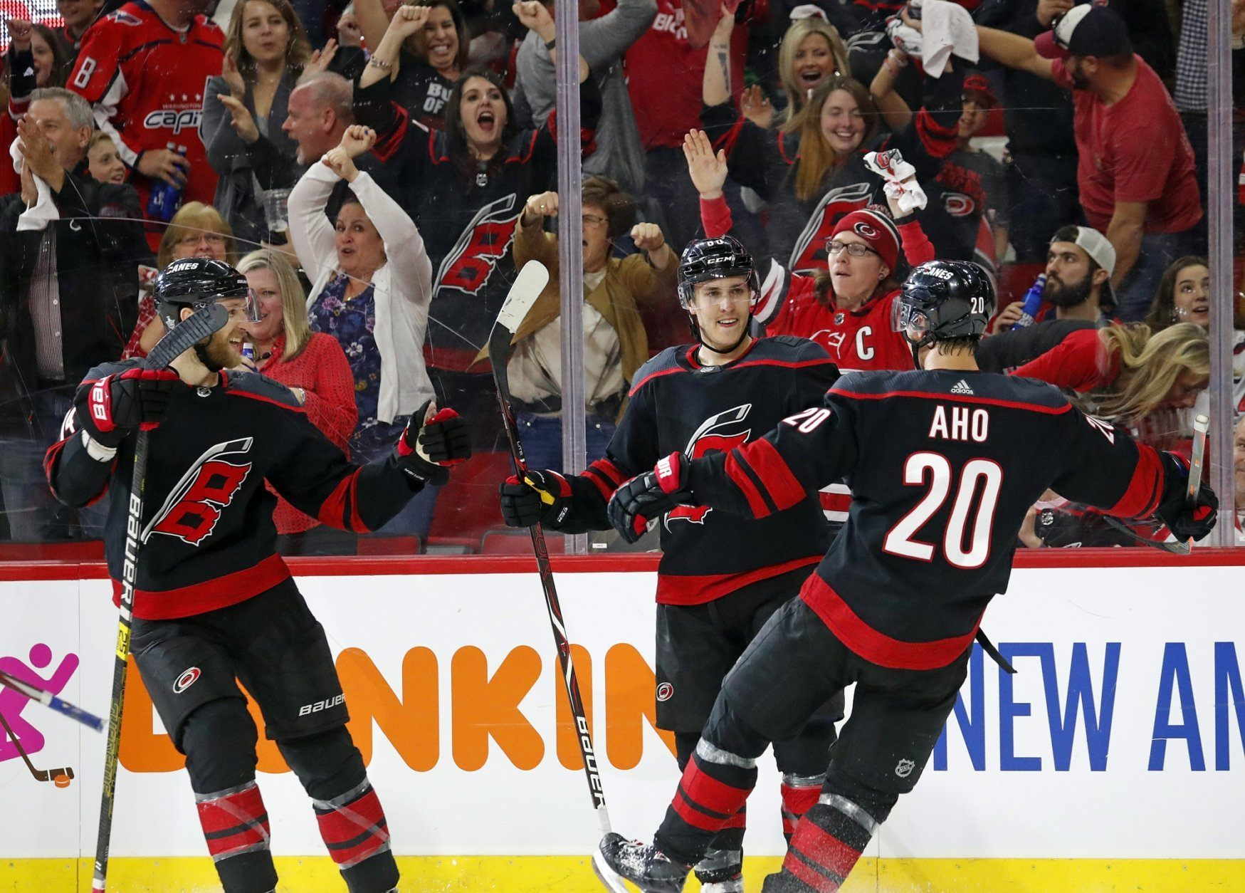 Carolina Hurricanes' Teuvo Teravainen (86) of Finland, celebrates his goal against the Washington Capitals with teammates Sebastian Aho (20) of Finland, and Jaccob Slavin (74) during the second period of Game 4 of an NHL hockey first-round playoff series in Raleigh, N.C, Thursday, April 18, 2019. The Hurricanes won 2-1 to tie the series at 2-2. (AP Photo/Karl B DeBlaker)