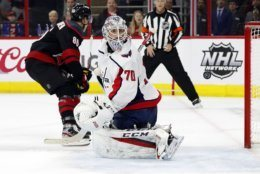Washington Capitals goaltender Braden Holtby (70) looks back at the puck after Carolina Hurricanes' Teuvo Teravainen (86), of Finland, scored during the second period of Game 4 of an NHL hockey first-round playoff series in Raleigh, N.C, Thursday, April 18, 2019, (AP Photo/Karl B DeBlaker)