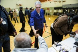Mayoral Candidate Toni Preckwinkle greets election judges at the 22nd precinct polling station in Chicago, Tuesday, April 2, 2019.  (James Foster/Chicago Sun-Times via AP)