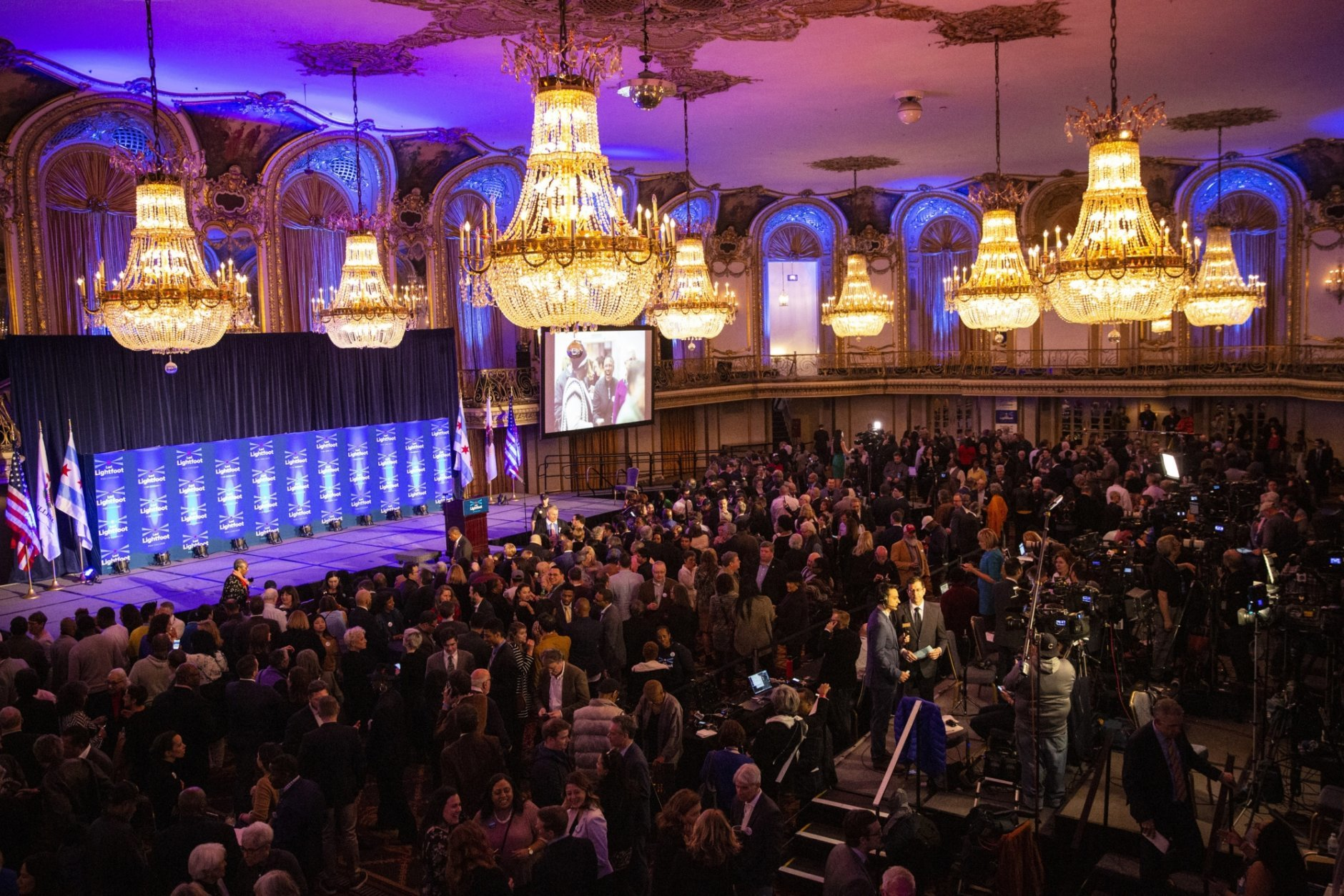 People gather in the Grand Ballroom at the Hilton Chicago for mayoral candidate Lori Lightfoot's election night rally, Tuesday, April 2, 2019. (Ashlee Rezin/Chicago Sun-Times via AP)