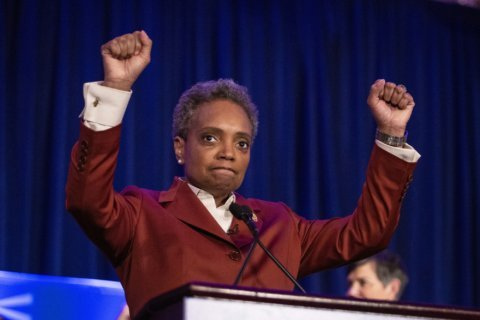 Lightfoot's win stirs hope for change in a divided Chicago