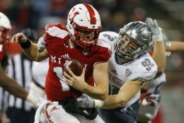 OXFORD, OH - NOVEMBER 15:  Maxx Crosby #92 of the Eastern Michigan Eagles sacks Gus Ragland #14 of the Miami Ohio Redhawks during the second half at Yager Stadium on November 15, 2017 in Oxford, Ohio.  (Photo by Michael Reaves/Getty Images)