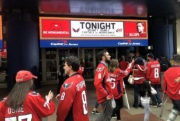 Caps fans get ready to head in to Capital One Arena ahead of game one against the Carolina Hurricanes. (WTOP/Mike Murillo)