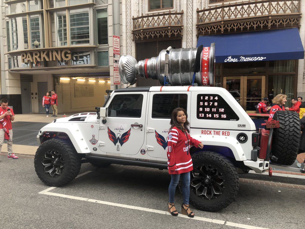 A jeep decked out in Capitals regalia parked outside Capital One Arena. (WTOP/Mike Murillo)