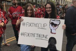 Fans outside Capital One Arena hold up a Game of Thrones-themed sign before the Caps host the Hurricanes in Game 7. (WTOP/Michelle Basch)