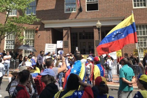 Opposing protests crowd streets outside Venezuelan Embassy in Georgetown