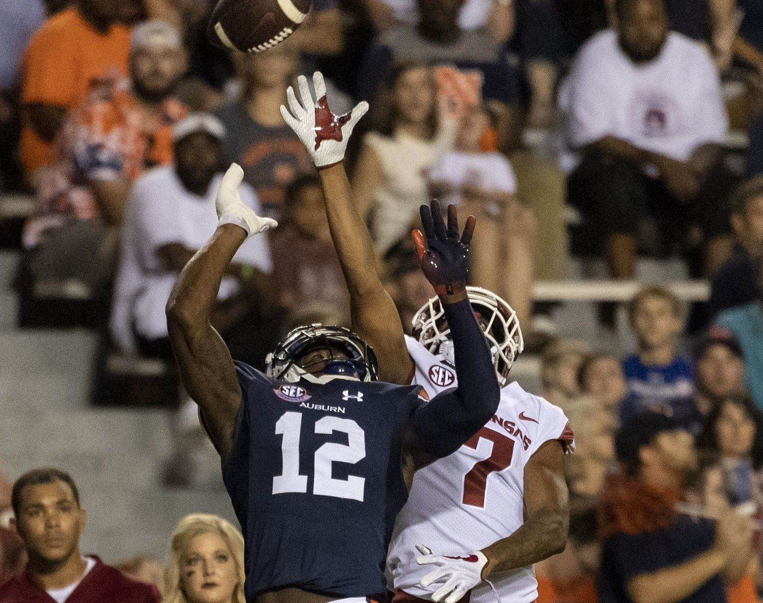 Auburn defensive back Jamel Dean (12) gets into position to defend a pass to Arkansas wide receiver Jonathan Nance (7) during the first half of an NCAA college football game, Saturday, Sept. 22, 2018, in Auburn, Ala. (AP Photo/Vasha Hunt)