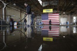 A volunteer vacuums water on the floor as they prepare for the announcement by Pete Buttigieg that he will seek the Democratic presidential nomination before a rally in South Bend, Ind., Sunday, April 14, 2019. Buttigieg, 37, is serving he second term as the mayor of South Bend. (AP Photo/Michael Conroy)