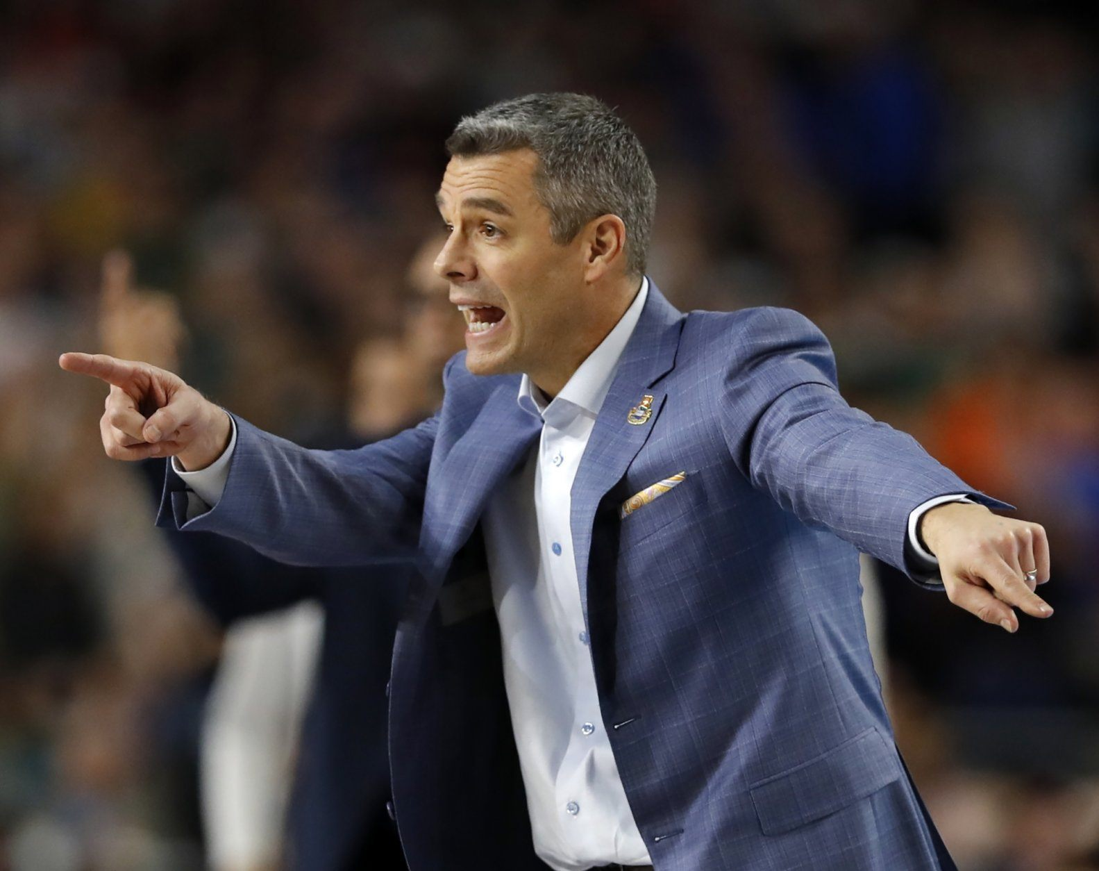 Virginia head coach Tony Bennett directs his team during the overtime in the championship of the Final Four NCAA college basketball tournament against Texas Tech, Monday, April 8, 2019, in Minneapolis. (AP Photo/Charlie Neibergall)