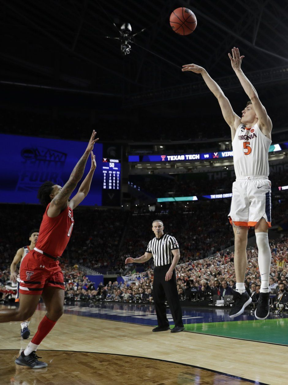 Virginia guard Kyle Guy (5) shoots over Texas Tech guard Kyler Edwards, left, during the second half in the championship game of the Final Four NCAA college basketball tournament, Monday, April 8, 2019, in Minneapolis. (AP Photo/David J. Phillip)