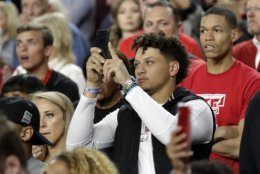 Kansas City Chiefs quarterback Patrick Mahomes takes pictures before the championship of the Final Four NCAA college basketball tournament between Texas Tech and Virginia, Monday, April 8, 2019, in Minneapolis. (AP Photo/David J. Phillip)
