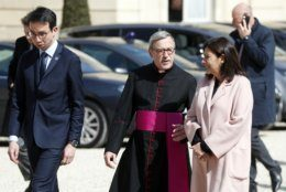 Rector of the Notre Dame Patrick Chauvet, center left, walks with Paris Mayor Anne Hidalgo, center right, at the Elysee Palace in Paris, prior to a meeting with French President Emmanuel Macron, Thursday, April 18, 2019. Nearly $1 billion has poured in from ordinary worshippers and high-powered magnates around the world to restore Notre Dame Cathedral in Paris after a massive fire. (AP Photo/Thibault Camus)