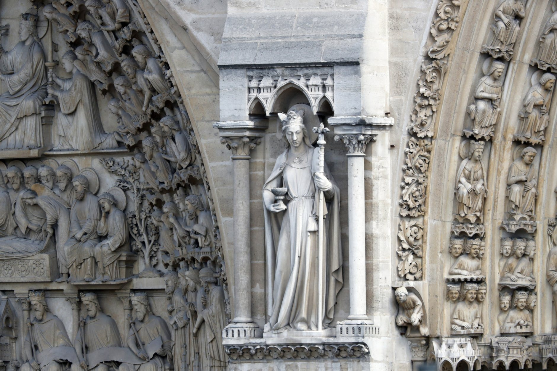 """A statue is pictured just outside Notre Dame cathedral Wednesday, April 17, 2019 in Paris. Notre Dame Cathedral would have been completely burned to the ground in a """"chain reaction collapse"""" had firefighters not moved rapidly in deploying their equipment to battle the blaze racing through the landmark monument, a Paris official said Wednesday. (AP Photo/Thibault Camus)"""