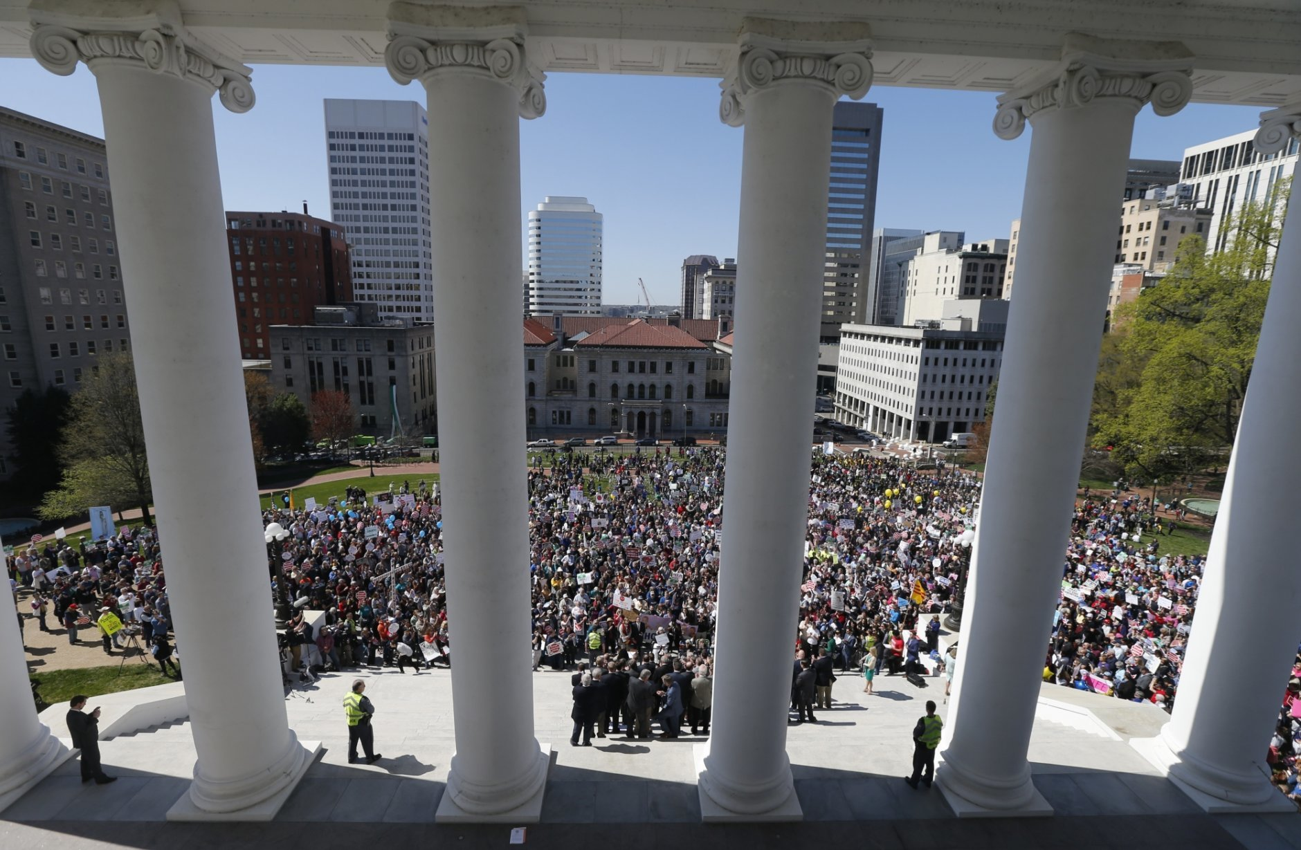 Right to Life marchers gather on the steps of the Capitol to listen to speakers at the Capitol in Richmond, Va., Wednesday, April 3, 2019. (AP Photo/Steve Helber)