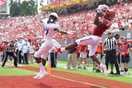 RALEIGH, NC - SEPTEMBER 01:  Kelvin Harmon #3 of the North Carolina State Wolfpack is called out of bounds as he makes a leaping catch against Taurus Carroll #27 of the James Madison Dukes during their game at Carter-Finley Stadium on September 1, 2018 in Raleigh, North Carolina.  (Photo by Grant Halverson/Getty Images)