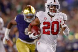 SOUTH BEND, IN - SEPTEMBER 29: Bryce Love #20 of the Stanford Cardinal runs for a touchdown during the game against the Notre Dame Fighting Irish at Notre Dame Stadium on September 29, 2018 in South Bend, Indiana. (Photo by Michael Hickey/Getty Images)