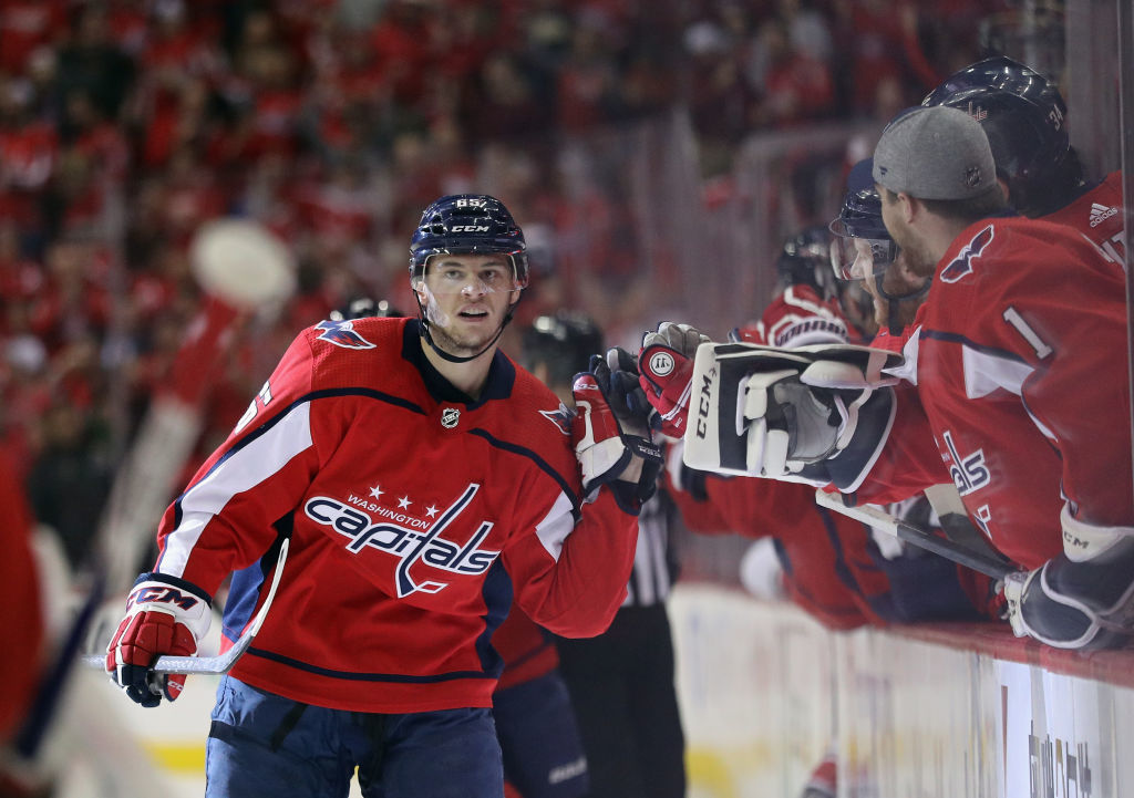 WASHINGTON, DC - APRIL 24: Andre Burakovsky #65 of the Washington Capitals celebrates his goal at 2:13 of the first period against the Carolina Hurricanes in Game Seven of the Eastern Conference First Round during the 2019 NHL Stanley Cup Playoffs at the Capital One Arena on April 24, 2019 in Washington, DC. (Photo by Patrick Smith/Getty Images)