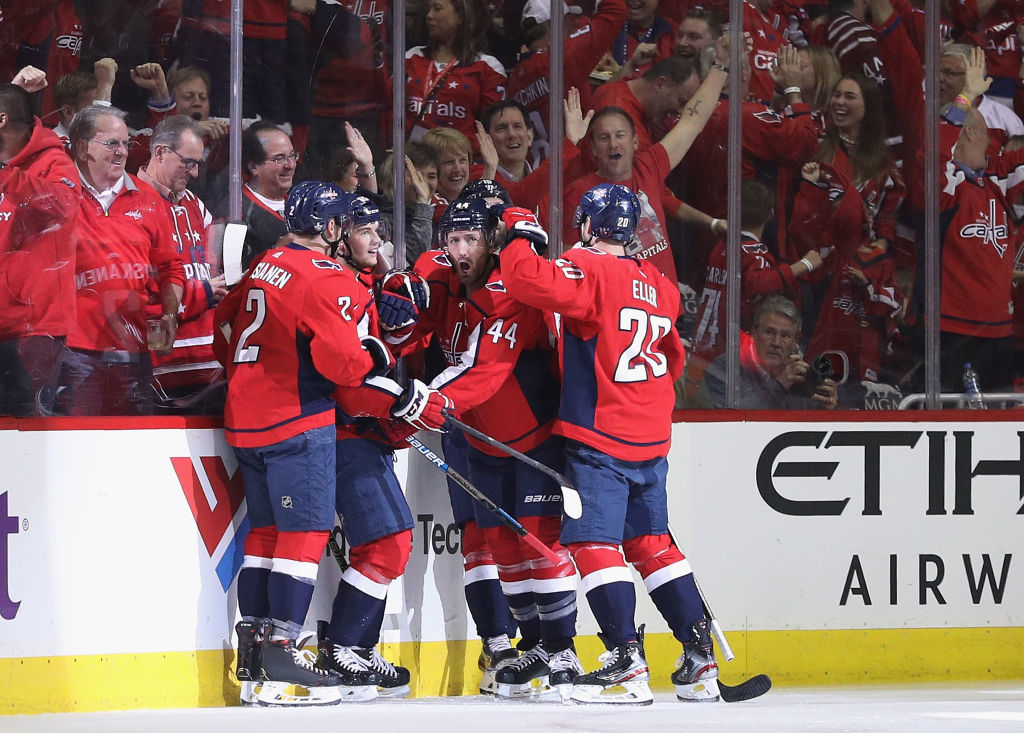 WASHINGTON, DC - APRIL 24: The Washington Capitals celebrate a goal by Andre Burakovsky #65 against the Carolina Hurricanes at 2:13 of the first period in Game Seven of the Eastern Conference First Round during the 2019 NHL Stanley Cup Playoffs at the Capital One Arena on April 24, 2019 in Washington, DC. (Photo by Patrick Smith/Getty Images)