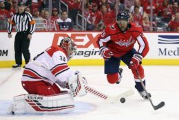WASHINGTON, DC - APRIL 24: Devante Smith-Pelly #25 of the Washington Capitals attempts to control the puck in front of Petr Mrazek #34 of the Carolina Hurricanes during the second period in Game Seven of the Eastern Conference First Round during the 2019 NHL Stanley Cup Playoffs at the Capital One Arena on April 24, 2019 in Washington, DC. (Photo by Patrick Smith/Getty Images)