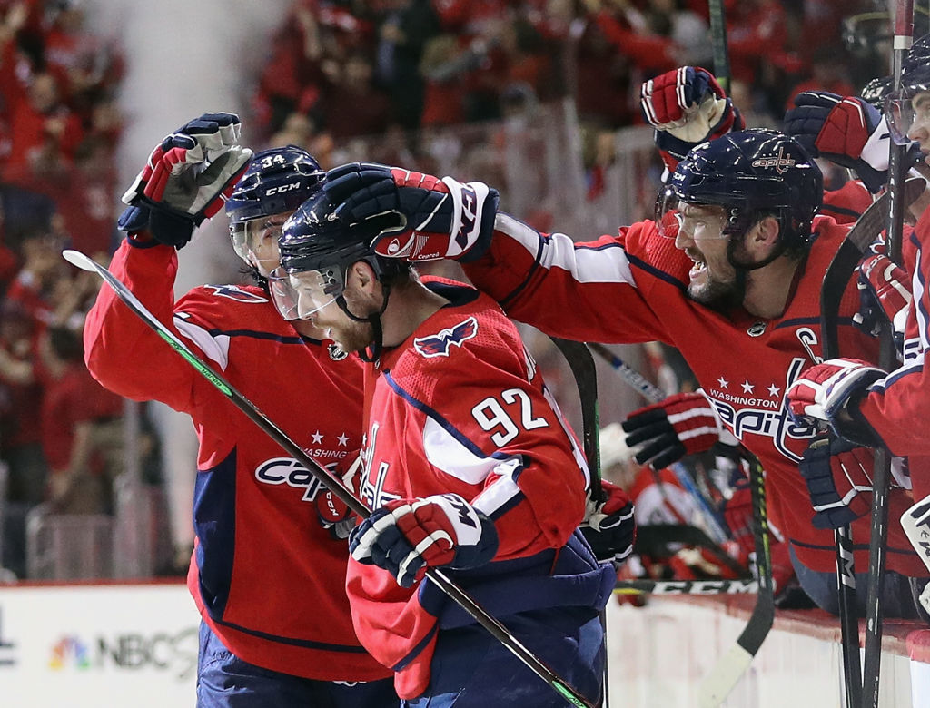 WASHINGTON, DC - APRIL 24: Evgeny Kuznetsov #92 of the Washington Capitals scores at 13:22 of the second period as Alex Ovechkin #8 of the Washington Capitals congratulates him during the game against the Carolina Hurricanes in Game Seven of the Eastern Conference First Round during the 2019 NHL Stanley Cup Playoffs at the Capital One Arena on April 24, 2019 in Washington, DC. (Photo by Patrick Smith/Getty Images)