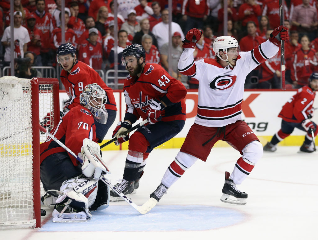 WASHINGTON, DC - APRIL 24: Brock McGinn #23 of the Carolina Hurricanes scores the game winning goal against Braden Holtby #70 of the Washington Capitals at 11:05 of the second overime period in Game Seven of the Eastern Conference First Round during the 2019 NHL Stanley Cup Playoffs at the Capital One Arena on April 24, 2019 in Washington, DC. The Hurricanes defeated the Capitals 4-3 in the second overtime period to move on to Round Two of the Stanley Cup playoffs. (Photo by Patrick Smith/Getty Images)