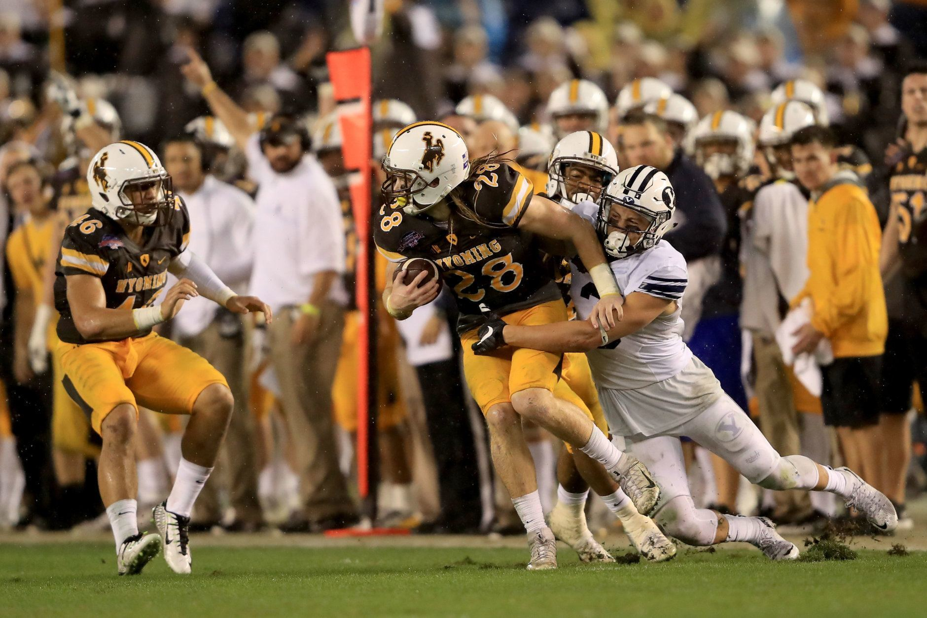 SAN DIEGO, CA - DECEMBER 21:  Andrew Wingard #28 of the Wyoming Cowboys intercepts a pass intended for Colby Pearson #3 of the Brigham Young Cougars  during the first half of  the Poinsettia Bowl at Qualcomm Stadium on December 21, 2016 in San Diego, California.  (Photo by Sean M. Haffey/Getty Images)