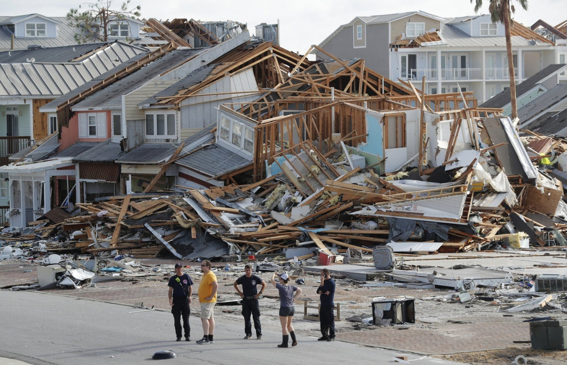 FILE-In this Thursday, Oct. 11, 2018. file photo, rescue personnel perform a search in the aftermath of Hurricane Michael in Mexico Beach, Fla. Weather forecasters have posthumously upgraded last fall's Hurricane Michael from a Category 4 storm to a Category 5. The National Oceanic and Atmospheric Administration announced the storm's upgraded status Friday, making Michael only the fourth storm on record to have hit the U.S. as a Category 5 hurricane. (AP Photo/Gerald Herbert, File)