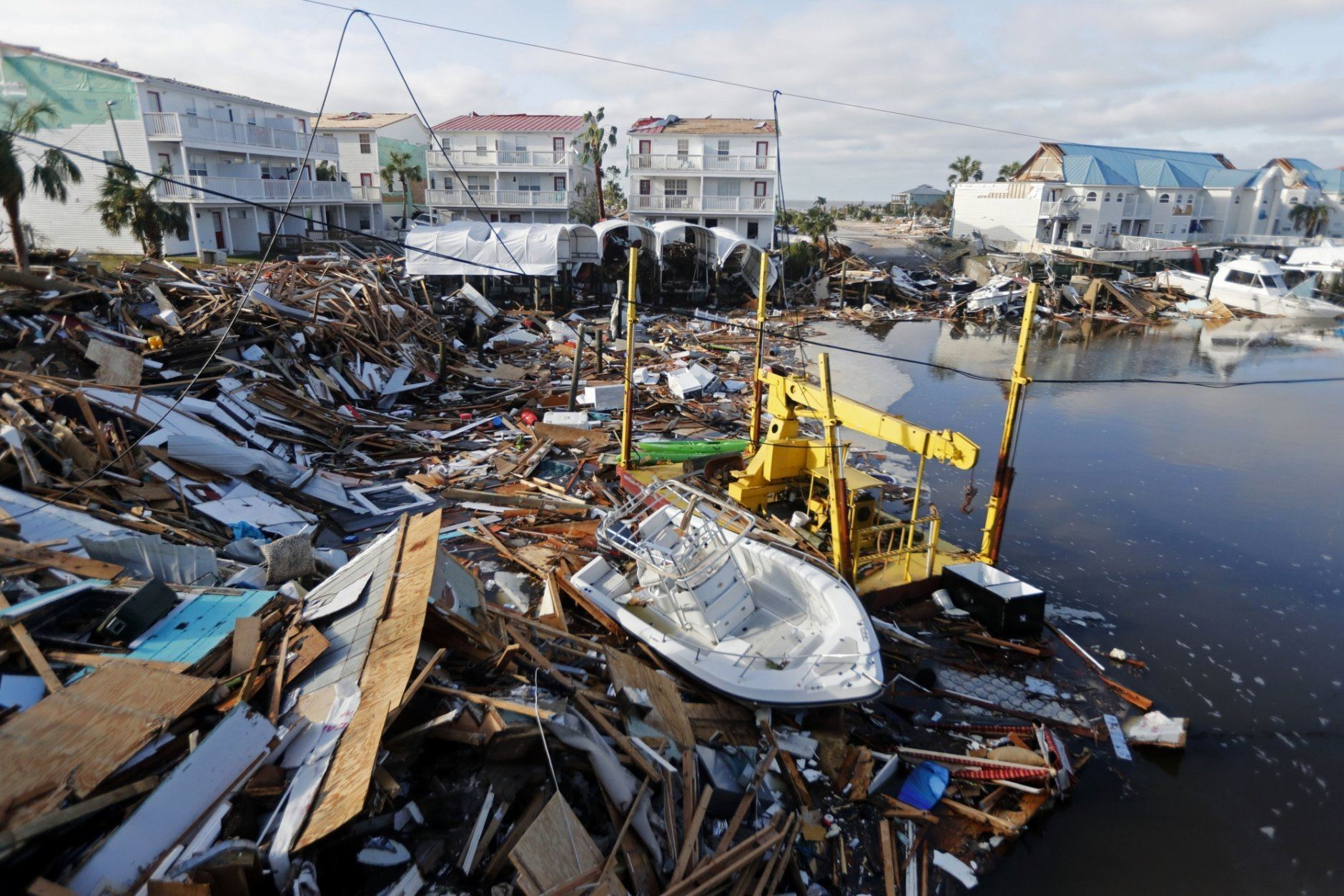 FILE - In this Oct. 11, 2018 file photo, a boat sits amidst debris in the aftermath of Hurricane Michael in Mexico Beach, Fla. Weather forecasters have posthumously upgraded last fall's Hurricane Michael from a Category 4 storm to a Category 5. The National Oceanic and Atmospheric Administration announced the storm's upgraded status Friday, making Michael only the fourth storm on record to have hit the U.S. as a Category 5 hurricane. (AP Photo/Gerald Herbert, File)