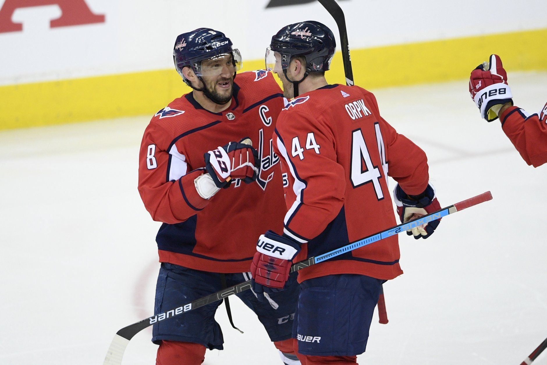 Washington Capitals left wing Alex Ovechkin (8), of Russia, celebrates with defenseman Brooks Orpik (44) after overtime in Game 2 of an NHL hockey first-round playoff series against the Carolina Hurricanes, Saturday, April 13, 2019, in Washington. The Capitals won 4-3 in overtime. (AP Photo/Nick Wass)