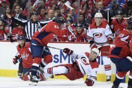 Washington Capitals right wing Tom Wilson (43) checks Carolina Hurricanes center Jordan Staal (11) during the first period of Game 1 of an NHL hockey first-round playoff series Thursday, April 11, 2019, in Washington. (AP Photo/Nick Wass)