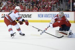 Carolina Hurricanes left wing Micheal Ferland (79) reaches for the puck in front of Washington Capitals goaltender Braden Holtby (70) during the first period of Game 1 of an NHL hockey first-round playoff series Thursday, April 11, 2019, in Washington. (AP Photo/Nick Wass)