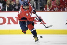 Washington Capitals left wing Alex Ovechkin (8), of Russia, shoots the puck during the second period of Game 2 of an NHL hockey first-round playoff series against the Carolina Hurricanes, Saturday, April 13, 2019, in Washington. (AP Photo/Nick Wass)