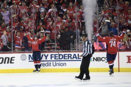 Washington Capitals center Nicklas Backstrom, left of Sweden, celebrates his goal with defenseman John Carlson (74) during the first period of Game 1 of an NHL hockey first-round playoff series against the Carolina Hurricanes, Thursday, April 11, 2019, in Washington. (AP Photo/Nick Wass)