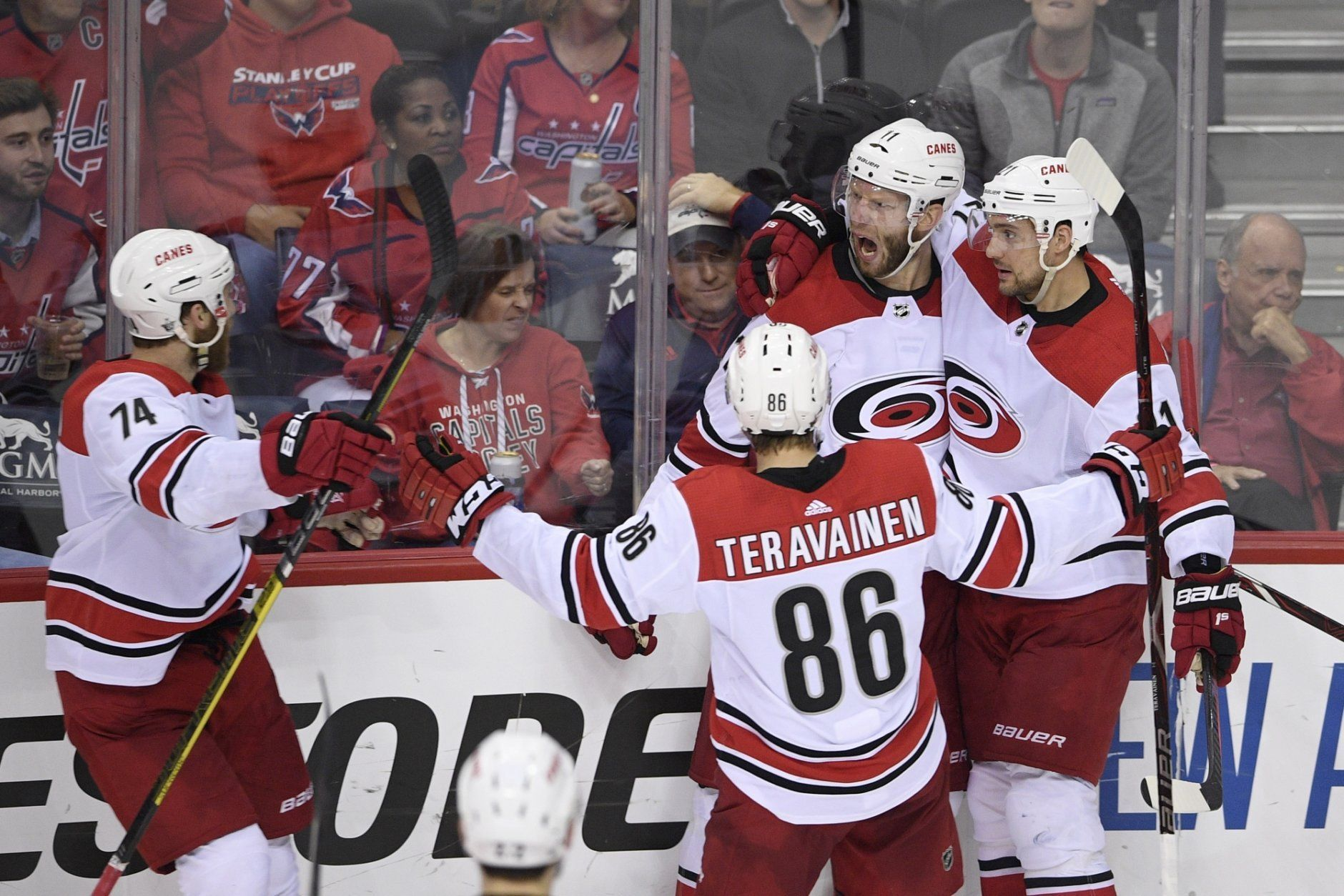 Carolina Hurricanes center Jordan Staal (11) celebrates his goal with right wing Nino Niederreiter, right, left wing Teuvo Teravainen (86), of Finland, and defenseman Jaccob Slavin (74) during the third period of Game 7 of an NHL hockey first-round playoff series against the Washington Capitals, Wednesday, April 24, 2019, in Washington. (AP Photo/Nick Wass)