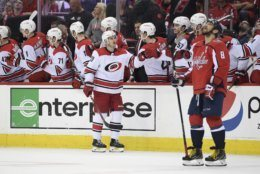 Carolina Hurricanes center Sebastian Aho (20), of Finland, celebrates his goal as Washington Capitals left wing Alex Ovechkin (8), of Russia, looks up at the scoreboard during the second period of Game 7 of an NHL hockey first-round playoff series, Wednesday, April 24, 2019, in Washington. (AP Photo/Nick Wass)