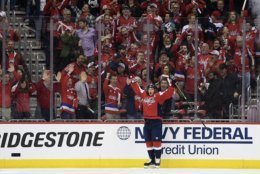 Washington Capitals center Nicklas Backstrom (19), of Sweden, celebrates his goal against the Carolina Hurricanes during the first period of Game 1 of an NHL hockey first-round playoff series Thursday, April 11, 2019, in Washington. (AP Photo/Nick Wass)