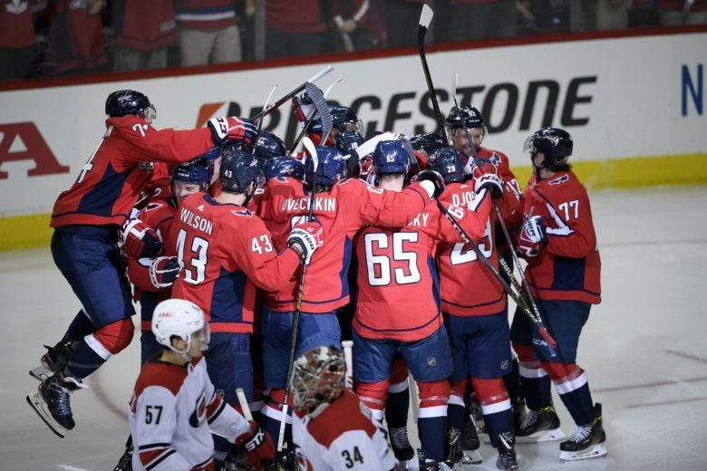 The Washington Capitals Celebrate After Overtime Of Game 2 Of An Nhl Hockey First Round Playoff Series As Carolina Hurricanes Defenseman Trevor