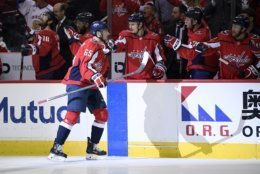 Washington Capitals left wing Andre Burakovsky (65) celebrates his goal during the first period of Game 7 of an NHL hockey first-round playoff series against the Carolina Hurricanes, Wednesday, April 24, 2019, in Washington. (AP Photo/Nick Wass)