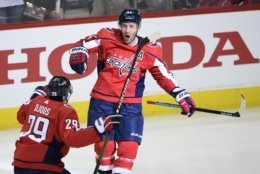 Washington Capitals defenseman Brooks Orpik (44) celebrates his game-winning goal with defenseman Christian Djoos (29), of Sweden, in overtime of Game 2 of an NHL hockey first-round playoff series against the Carolina Hurricanes, Saturday, April 13, 2019, in Washington. The Capitals won 4-3 in overtime. (AP Photo/Nick Wass)