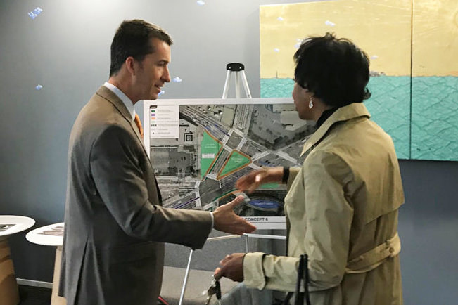 DDOT Staffer shows plans to Advisory Neighborhood Commissioner Sylvia Pinckney, 5E. (WTOP/Dick Uliano)