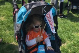 Cecily Colburn, 3, was among those who came in a stroller to the Capitol. Her father Casey says he and his wife Rochelle, a Hill staffer, were never able to get the congressional day care that's offered. They were too low on a waiting list. (WTOP/Mitchell Miller)