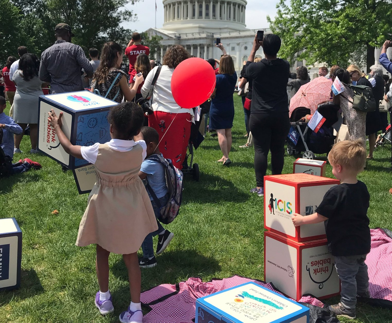 Families gathered Tuesday for the Strolling Thunder rally at the Capitol, where they called on Congress to pass legislation for federal paid family leave and to do more to address the cost of day care. (WTOP/Mitchell Miller)