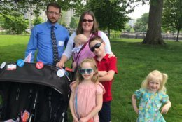 The McKenney family came all the way from Maine for the rally outside of the Capitol. Parents Ryan and Erika brought their four children. (WTOP/Mitchell Miller)