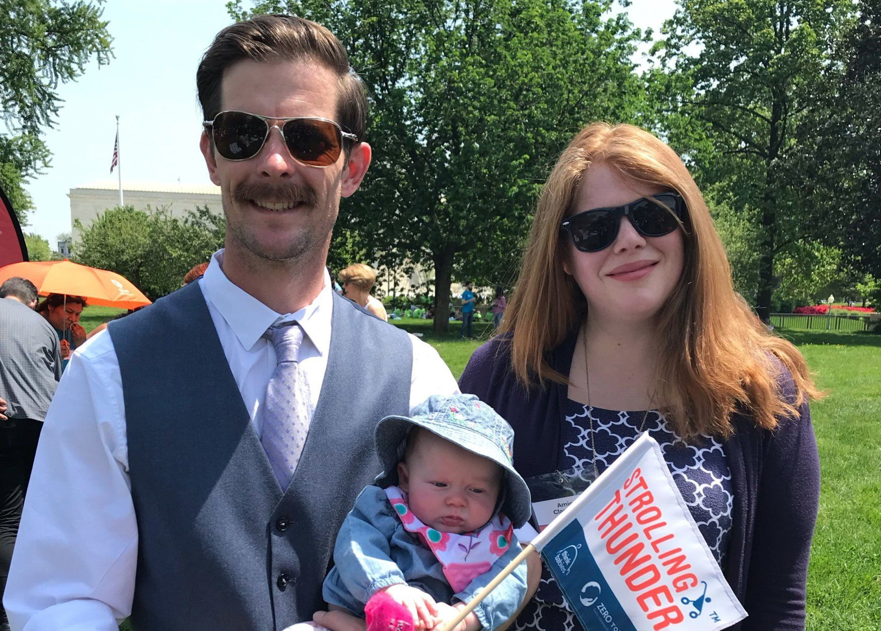 Ryan and Amie Clampitt and their 3-month-old daughter Penelope came from Bozeman, Montana, for the rally. (WTOP/Mitchell Miller)