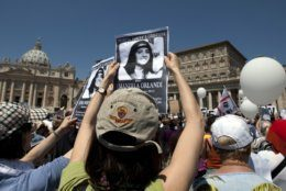 """FILE - In this May 27, 2012, file photo, demonstrators hold pictures of Emanuela Orlandi reading """"march for truth and justice for Emanuela"""" during Pope Benedict XVI's Regina Coeli prayer in St. Peter's square, at the Vatican. The Vatican has for the first time opened its own investigation into the case of Emanuela Orlandi, a 15-year-old Vatican citizen who disappeared in the summer of 1983. (AP Photo/Andrew Medichini, File)"""